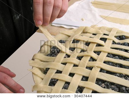 Weaving the lattice top of a blueberry pie