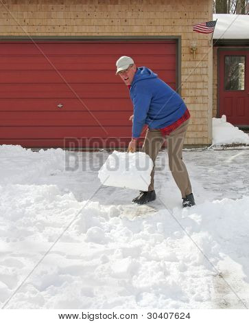 Upbeat man shoveling snow