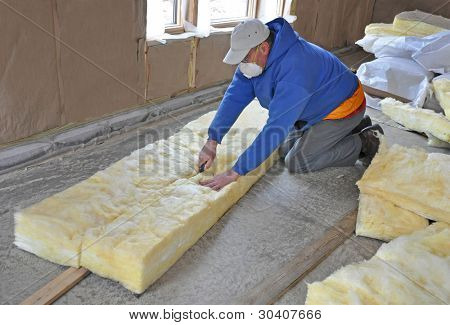 Man cutting fiberglass insulation