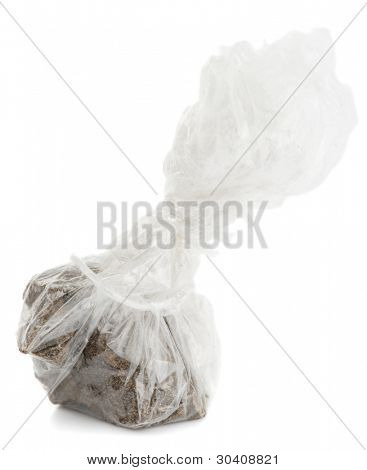 Substance looking exactly like hashish in plastic wrapping, isolated