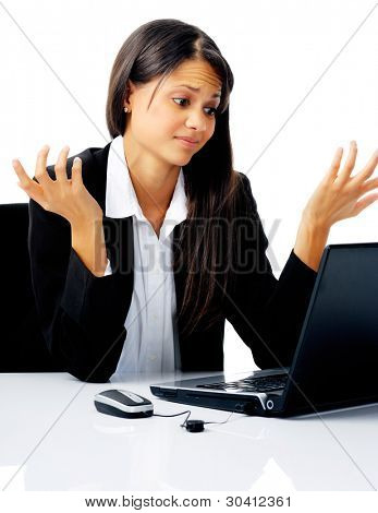 businesswoman working at her desk with laptop computer is stressed, frustrated and overwhelmed by depression business situations. isolated on white