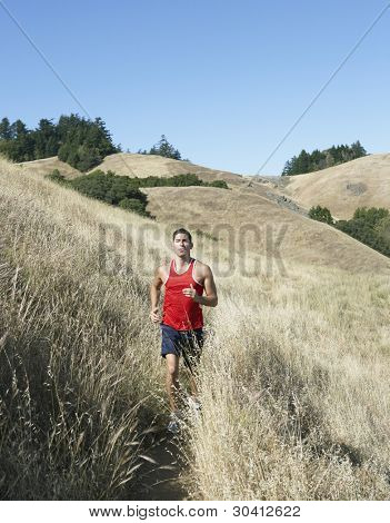 Athlete running in the countryside