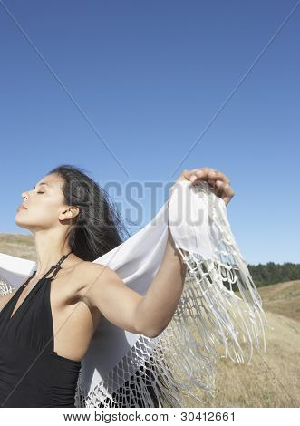 Sensual woman standing in countryside