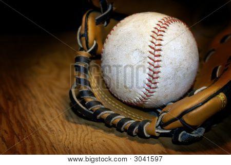 Closeup Of Baseball And Glove.