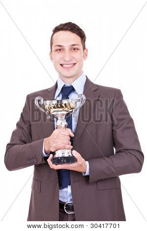 Business man holding a gold and silver cup trophy, isolated on white background. winning businessman holding his award