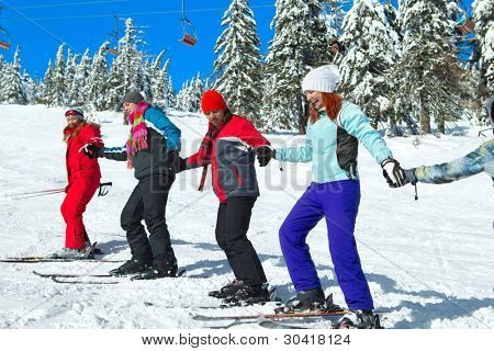 Group of skiers come upstairs snowy mountains (ski touring)