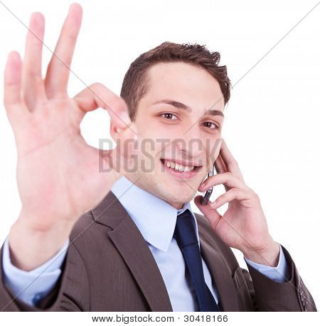 business man on the phone approving the good news on white background