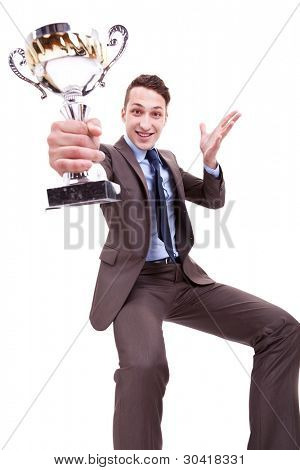 picture of an excited young business man winning a nice trophy on white background . excited businessman holding a gold and silver trophy cup