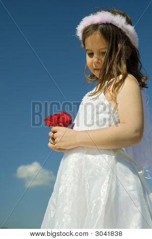 Girl Holding Red Roses