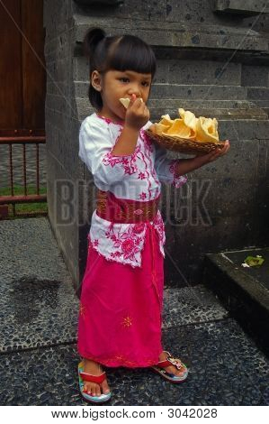Balinese (Indonesian) Girl Eating Prawn Crackers