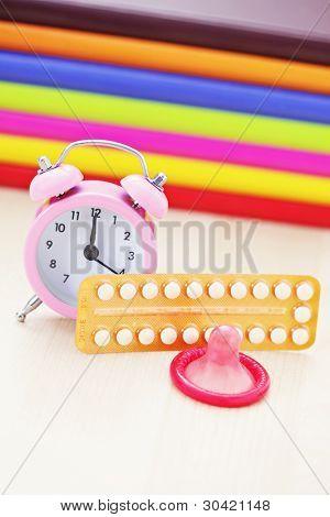 birth control pill with condom - healthcare and medicine