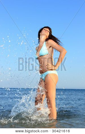 Woman on the beach in the summertime