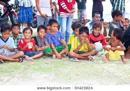 LOMBOK,INDONESIA- FEBRUARY 11: Portrait of Sasak tribal children in Kuta village on February 11,2012 Lombok, Indonesia