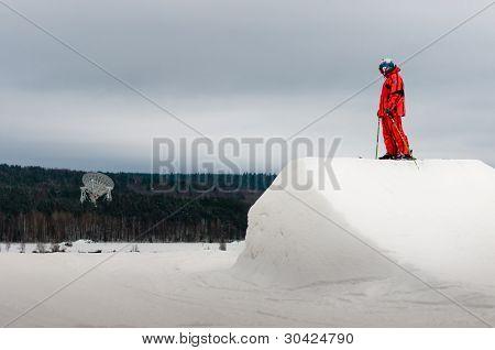 Skier Standing On Springboard Peak