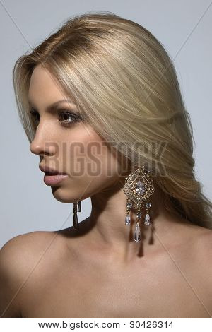 Sexy Girl With Blond Hair And Large Earrings