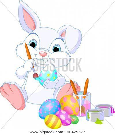 niedliche Osterhasen malen ein Ei