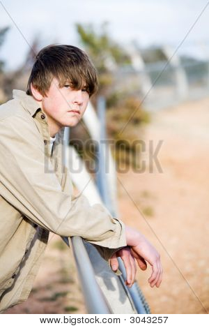 Teen On Fence Portrait