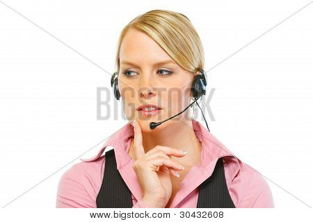 Portrait Of Thoughtful Woman Employee In Headset