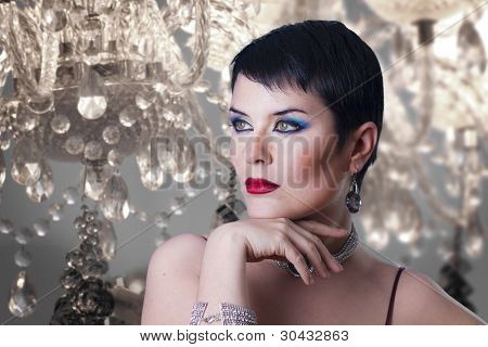 glamorous stylish short haired woman with jewellery
