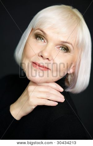 Portrait of a mature lady smiling positively at camera