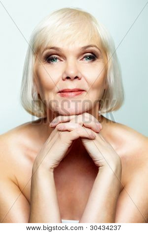 Mature lady looking calmly at camera