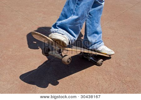 Driving on a skateboard on asphalt.