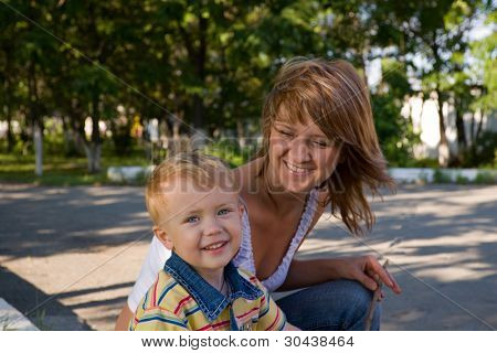 Mom and the son in park. They are dared.
