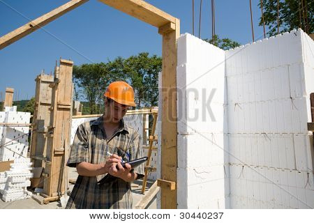 The inspector on a building site.