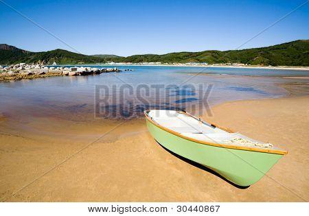 Plastic boat on coast of a sea gulf