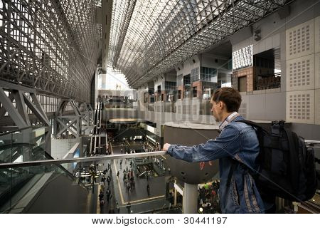 Tourist.A modern architectural steel structure of Kyoto station.Japan