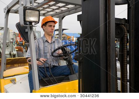 Man working on the forklift