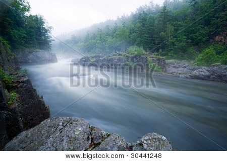 Mountain river. Above water the fog is laid. In the sky haze.Evening.Long Exposure