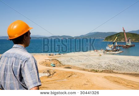 Builder.Construction of new seaport(oil harbor).Floating cranes.