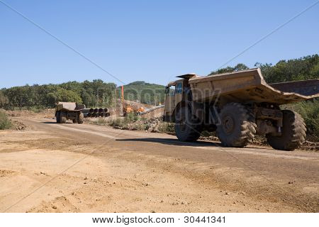 Dump truck on a working platform