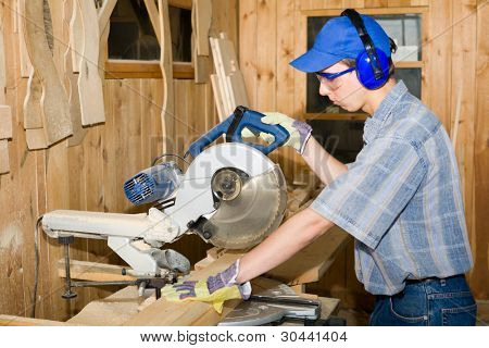 A carpenter(sawman) at work.