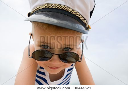 Ship's little boy.Cap.Sunglasses.