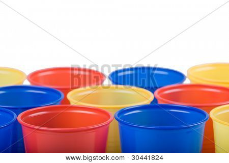 Multi coloured disposable plastic cups on a white background