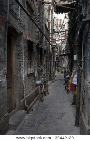 Traditional Chinese alley in old area of Shanghai. China. Inscriptions on walls are not actual advertising!