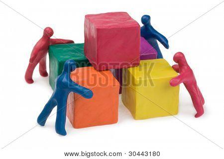 Trabajo en equipo de negocios - problemas colectivos. Plastilina. Aislado.