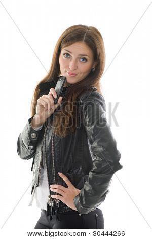 Beautiful girl in black leather jacket and a mobile phone in his hand