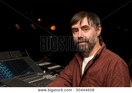 Sound engineer for sound mixer console in a nightclub.