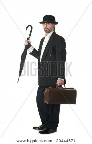 Middle aged businessman in a retro business suit with a bag and umbrella.