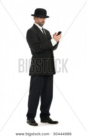 Middle-aged businessman looking at his smartphone.