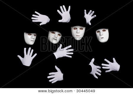 Portrait of a team of young break dancers in masks on a black background.