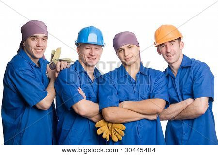 A friendly young team of construction workers. Isolated on white.