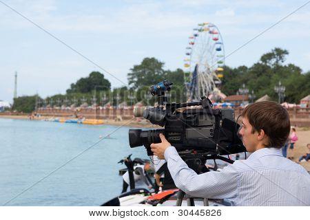 Operator of a television camera for work. Vladivostok. Russia.