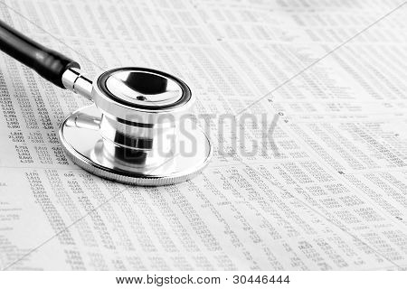 Stethoscope On Financial Newspaper