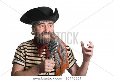 Singer dressed as sea pirate sings in an old microphone.