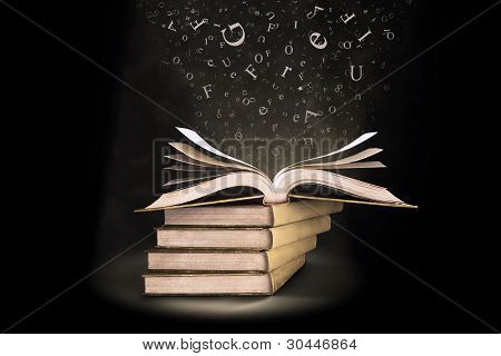 Open Book With Letters Falling Into The Pages