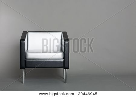 Lounge chair with a gray background. Modern design.